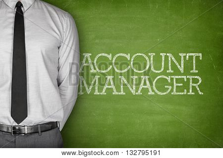 Account manager on blackboard with businessman standing side