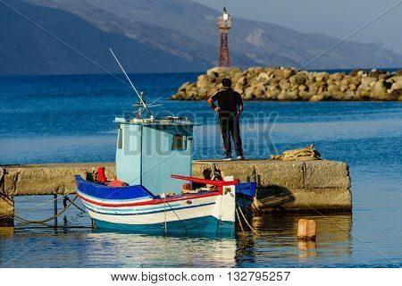 Fishing boat in the Harbor of the picturesque village of Kardamena, Kos island, Dodecanese, Greece.