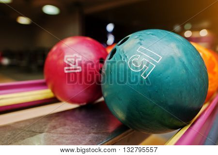 Two Colored Bowling Balls Of Number 15 And 14