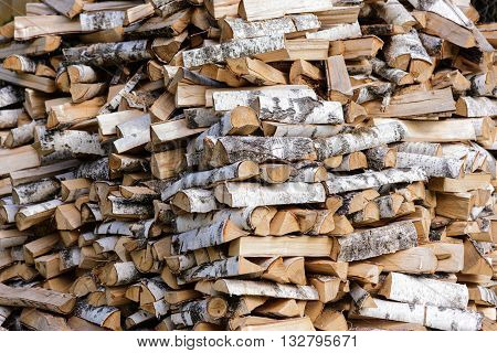 Stack of chopped firewood prepared for winter.