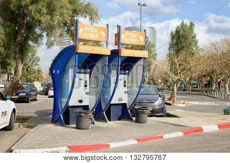 Tel Aviv-Yafo, Israel - January 21, 2016: Two electronic payment machines in huge parking lot in Tel Aviv beach area.