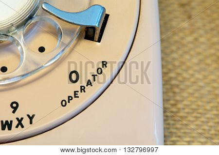 Cream colored rotary style telephone up close on the Operator
