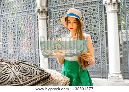 Young female traveler standing on the beautiful gothic skeleton background near Cavalli-franchetti palace in Venice