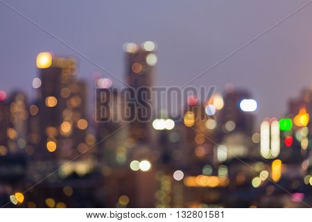 City blurred lights and office building, abstract bokeh light background