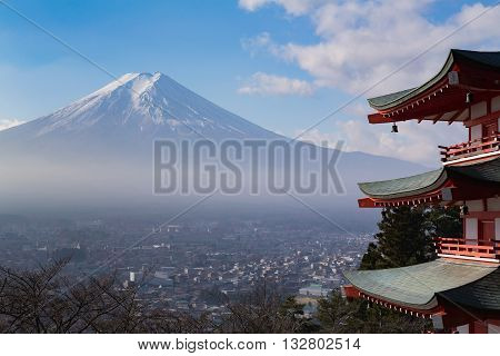 Mt. Fuji aerial viewed from behind red Chureito Pagoda, in late winter, Japan