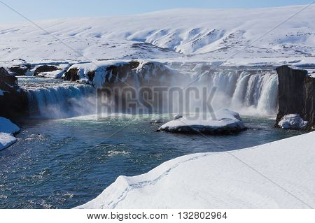Frozen waterfall with clear blue water at late winter, Gullfoss, Iceland