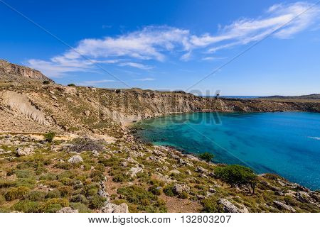 A picturesque Bay with blue water near the village of Lindos, Rhodes island, Dodecanese, Greece.