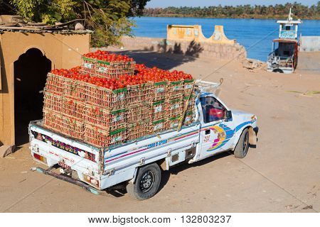 ASWAN, EGYPT - FEBRUARY 9, 2016: Pick up truck transporting tomatoes.