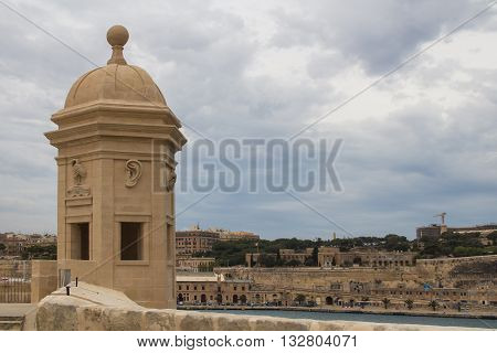 Park Gardjola Gardens in a part of fortification of the city Senglea at the mediterranean island Malta. Tower with a view on the maltese capital Valletta.