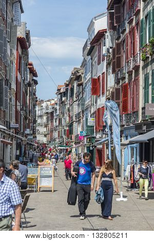 Bayonne France - May 21 2016: People walking in Rue de Espagne street the main shopping street in Bayonne. Aquitaine France.