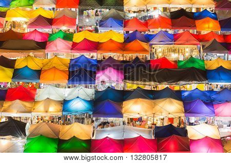 Arial view roof top over multiple colours weekend nigh market