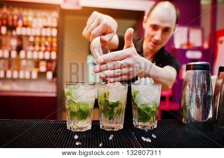 Bartender Preparing Mojito Cocktail Drink At The Bar