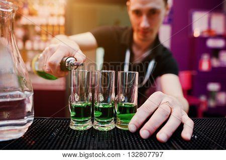 Barman Preparing Green Mexican Cocktail Drink At The Bar