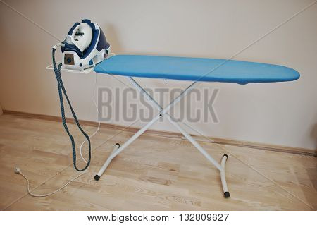 Ironing board with steam iron system indoor