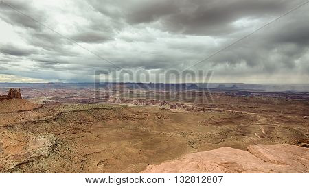 Storm clouds and rain at Grand View Point Overlook, in the Islands in the Sky District of Canyonlands National Park, near Moab, Utah.