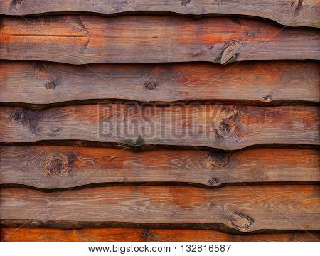 A fence made of pine boards. Covered with stains. wood texture.