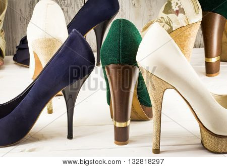 various womens shoes on wooden background, different style