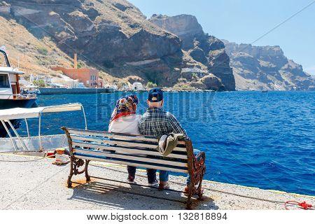 Passenger ship in the old port of Fira early sunny morning. Santorini. Greece.