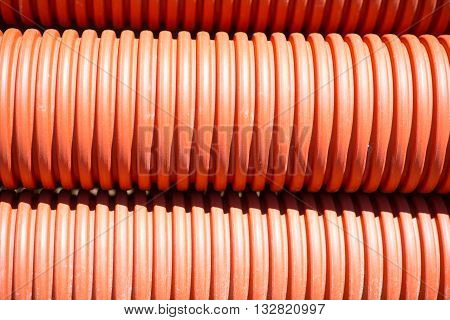 Cool background. A large amount of red tubes, picture may be used as a background