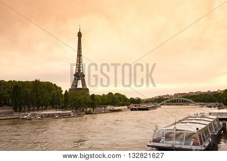 PARIS FRANCE - MAY 07 2015: View from river Seine at famous Tour Eiffel in the evening Paris France