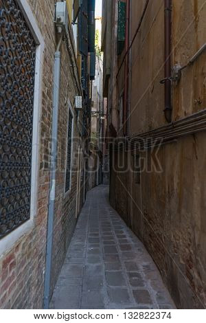 Very narrow old vintage street in Venice. Curvy narrow road in Venice that caused me fear.