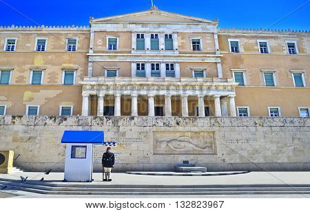 ATHENS GREECE, MAY 27 2016: greek evzones - greek tsolias - guarding the presidential mansion in front of the tomb of the unknown soldier - army infantry. Editorial use.
