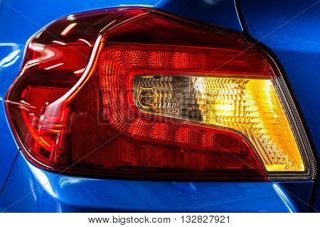 Car detailing series : Closeup of clean taillights with flashing signal light