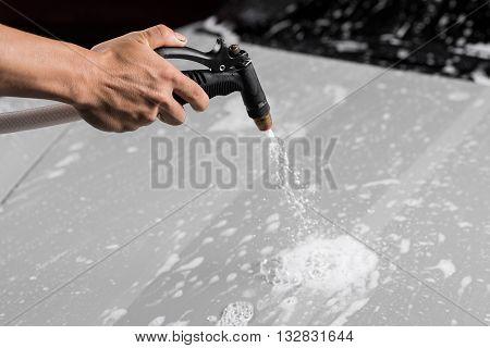 Car detailing series : Spraying foam on grey car bonnet