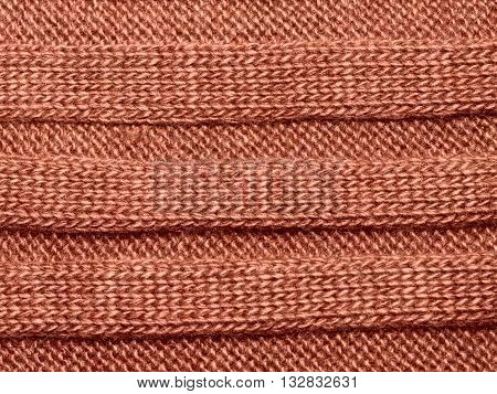 Brown ribbed knit wool like texture textured fabrics knitted jersey wool as a background pattern upholstery