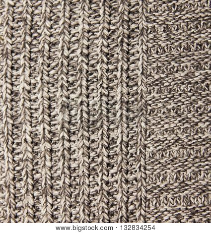 gray knitted wool knitted warm clothes for the winter fabric texture background