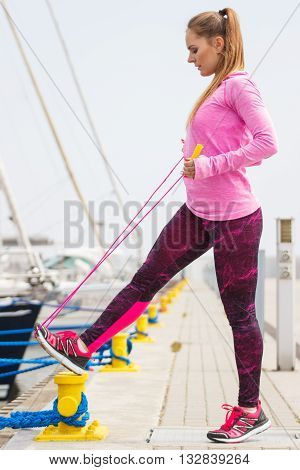 Girl In Sports Wear Exercising With Jumping Rope In Seaport, Healthy Active Lifestyle