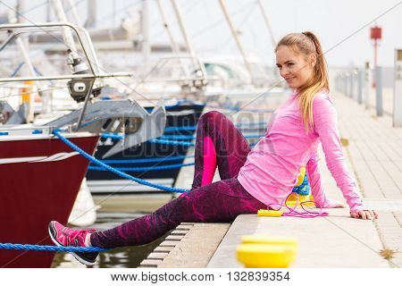 Slim Girl In Sports Wear Resting After Exercise In Seaport, Healthy Active Lifestyle