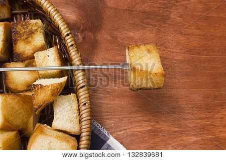 Crackers for cheese fondue on a wooden background
