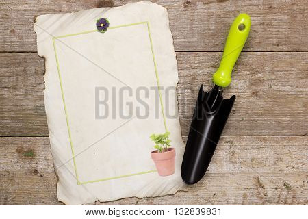 Shovel for horticulture and image on a wooden background