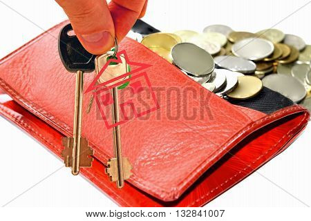 The keys to the apartment on the background of money