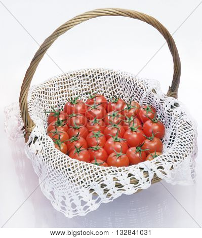 BASKET FULL OF CHERRY TOMATOES