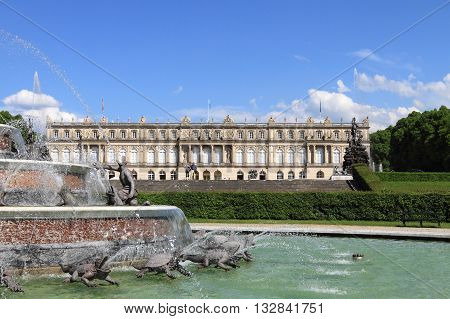 CHIEMSEE, GERMANY - MAY 11, 2011: Herrenchiemsee palace and garden on May 11, 2011 in Chiemsee, Germany. It is a landmark palace in Germany and an imitation of Versailles palace.