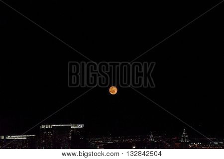 MAY 30, 2016 LAS VEGAS, NV -- View of moon from The Palms Casino with view of Aria Casino on a dark night -- MAY 30, 2016 LAS VEGAS, NV