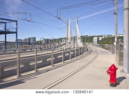 Tillikum crossing bridge and railtracks Portland Oregon.
