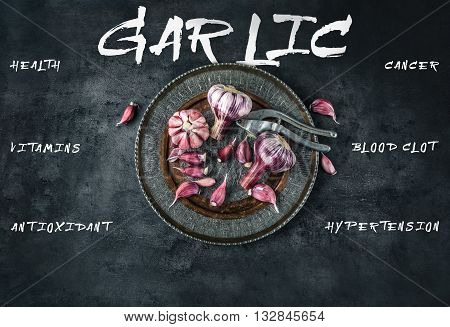 Garlic. Fresh garlic. Red garlic. Garlic press. Violet garlic.Garlic background. garlic bulbs. Medical healt concept. Englsh text.