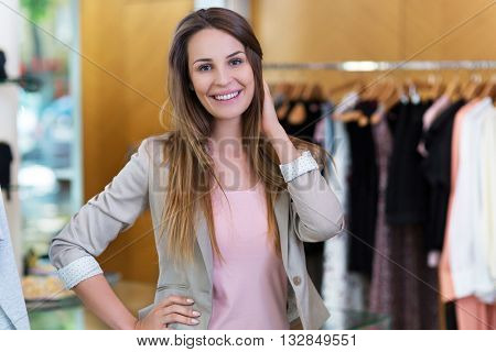 Woman in her clothing boutique