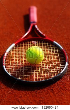 Tennis ball and racket on the court