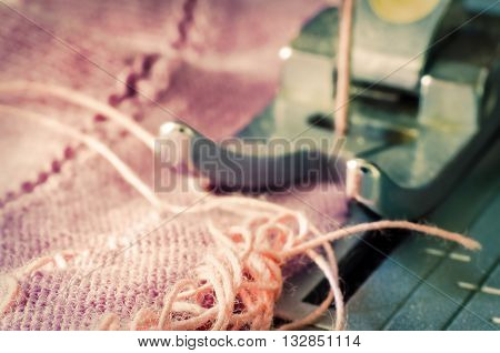 a needle of sewing machine close up