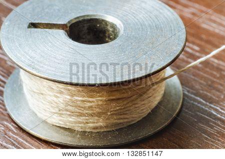 a brown thread bobbin macro close up