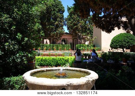 MALAGA, SPAIN - JULY 11, 2008 - Stone fountain in the castle gardens (Patio de los Surtidores in the Alcazaba) Malaga Malaga Province Andalucia Spain Western Europe, July 11, 2008.