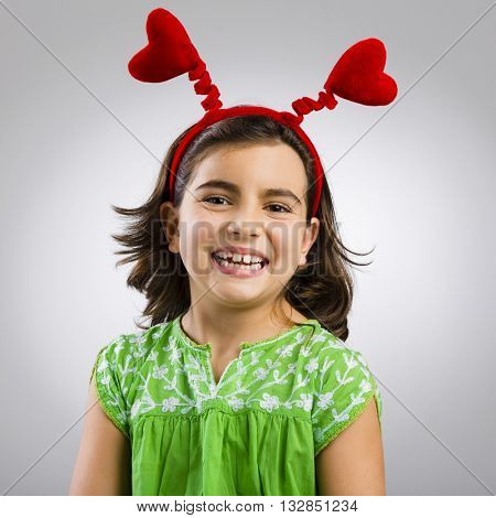 Studio portrait of a little girl wearing a headband with hearts