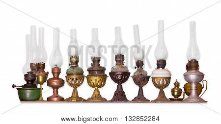Several various old flat wick kerosene lamp on a light background