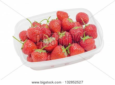 Ripe fresh garden strawberry fruits in the plastic tray on light background