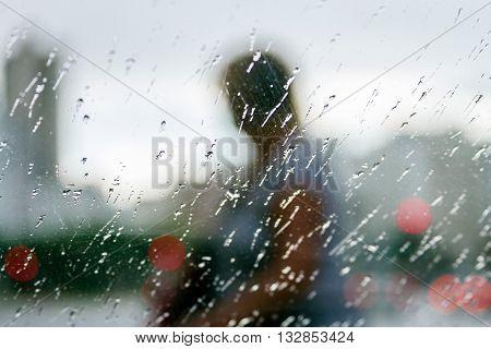 Silhouette of a person seen through a glass fogged
