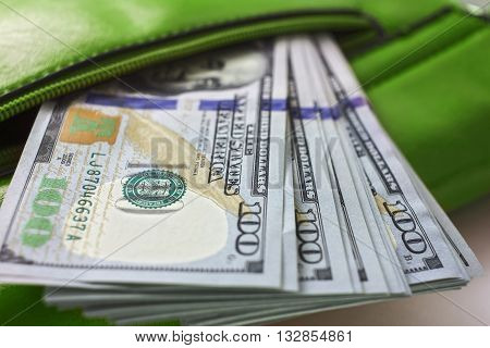 dollar notes in a wallet hundred-dollar bills are in a bag to spend money in your wallet close